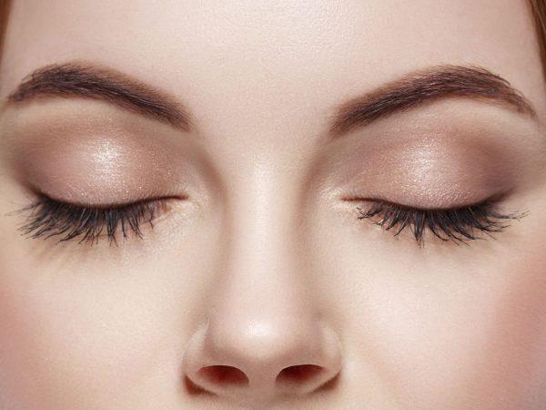 Eyes woman closed eyebrow eyes lashes. Studio.
